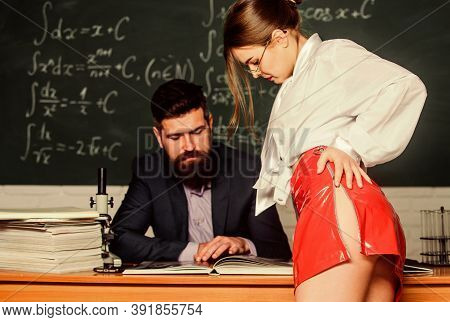 Temptation To Knowledge. Bearded Man And Female Student Read Book. Temptation Concept. Sensual Woman