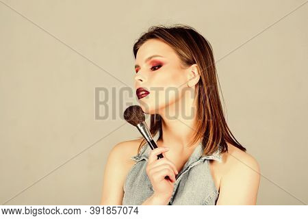 Looking Good And Feeling Confident. Attractive Woman Applying Makeup Brush. Professional Makeup Supp