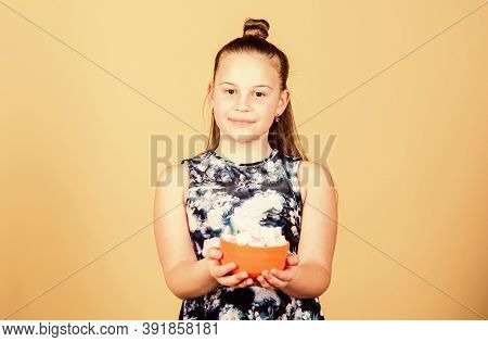 Marshmallow Challenge. Girl Smiling Face Hold Bowl With Sweet Marshmallows In Hand Beige Background.
