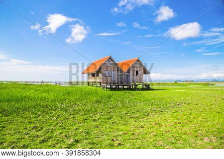 Twin Old House On Wetland At Talay Noi Lake At Phatthalung,southern Of Thailand.