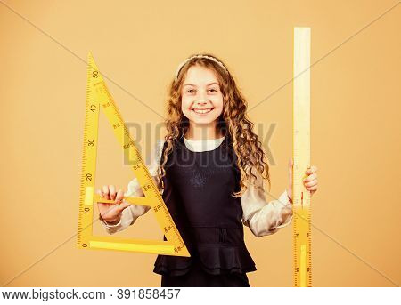 Pupil Girl With Big Rulers. Stem School Disciplines. Math Lesson. Education And Knowledge. Small Gir