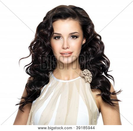Beautiful brunette woman with beauty long curly hairstyle. Fashion model with wavy hairs poster