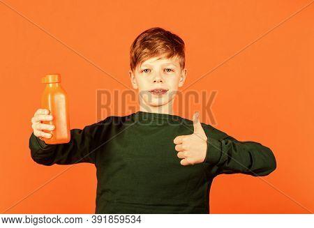 Smoothie Detox Cocktail. Refreshing Beverage Concept. Water Balance. Small Child Drink Juice Orange