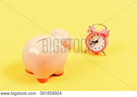 It Is Time To Pay. Credit Debt. Piggy Bank Pink Pig And Little Alarm Clock. Financial Crisis. Econom