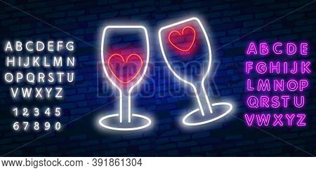 Two Neon Glasses With Hearts. Glowing Neon Sign Of Champagne. Night Illuminated Brick Wall. Champagn