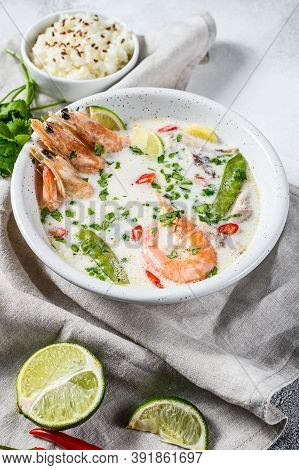 Tom Kha Gai. Creamy Coconut Soup With Chicken And Shrimp. Thai Food. Gray Background. Top View.