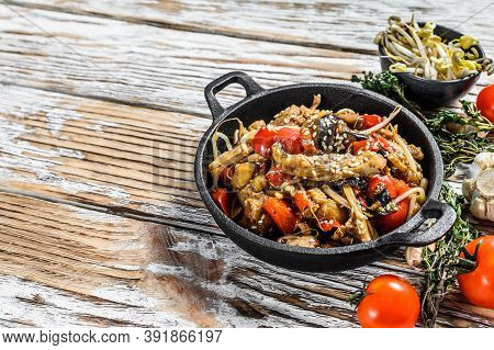 Chicken Stir-fry In A Pan. Wok Udon Noodles. Traditional Asian Food. White Background. Top View. Cop