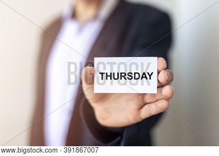 Thursday Word Conept In Businessman Hand, Day Calendar.