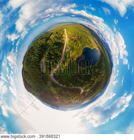 Little planet transformation of spherical panorama 360 degrees of the lake of Kidelyu near the Ulagan mountain pass, Altai Republic, Russia. Aerial drone view, virtual reality content.