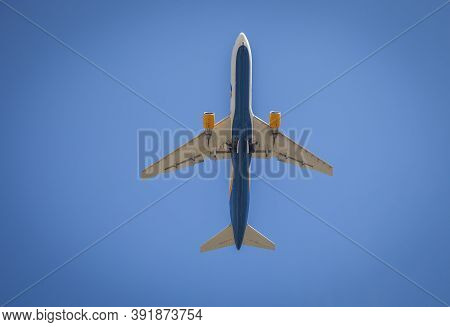 Plane Flies In The Sky. Bottom View. Takeoff And Landing. Arrival And Departure. Passenger Plane Iso