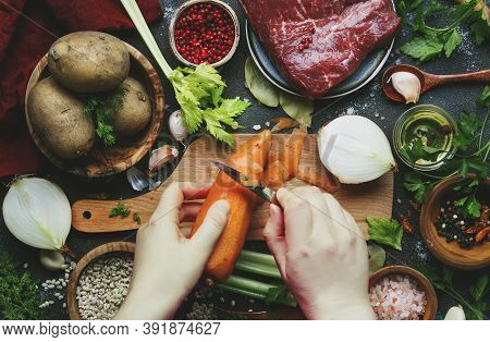Womens Hands Are Cleaning Carrots. Cooking Food Background. Fresh Organic Vegetables, Ingredients, S