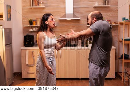 Furious Couple Fighting In The Kitchen, Family With Violence Issues. Traumatised Helpless Terrified
