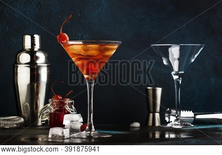 Classic Alcoholic Cocktail Manhattan With Bourbon, Red Vemuth, Bitter, Ice And Cocktail Cherry In Gl