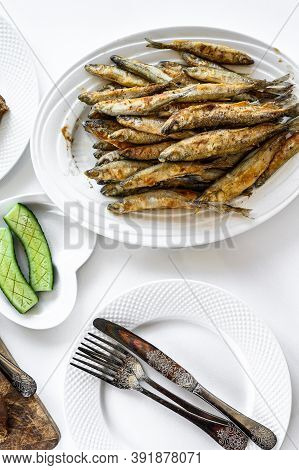 Dinner With Fried Smelt And Vegetables. White Background. Top View