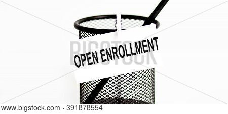 Word Open Enrollment On A Leaf On A Glass For Pencils .the Concept Of Working In Office .