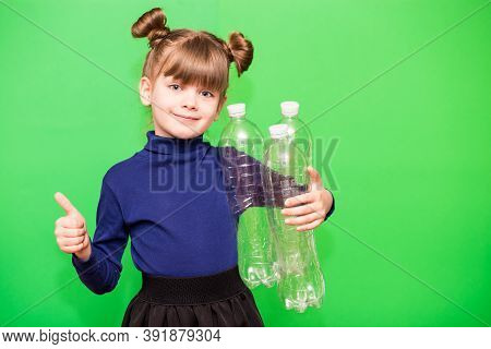 Positive Little Ecologist Girl Holding Trash Bag With Plastic Bottles And Show Thumb Up Isolated On