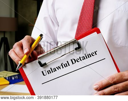 Unlawful Detainer Papers In The Hands Of Man.