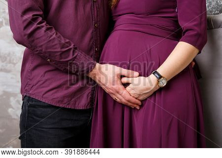 Image Of Husband Standing And Holding Belly Of Pregnant Wife Hands. Woman, Girl And Loving Handsome