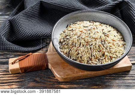 Organic Rice, Mixed Rice In A Bowl. Black Background. Top View