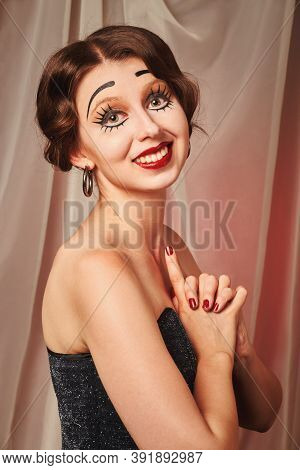 Fun Young Woman With Vintage Pinup Makeup Making Dolly Face Looking At Camera