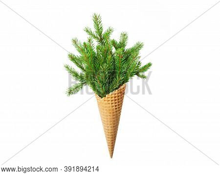 Ice Cream Cone With Sprigs Of Fir. White Isolated Background. New Year. Christmas Postcard. Copy Spa