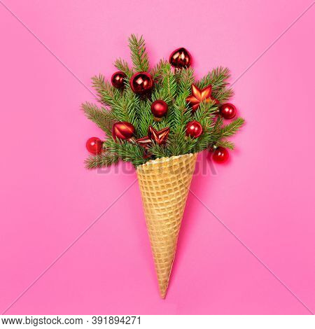 Ice Cream Cone With Sprigs Of Fir On A Pink Background. New Year. Christmas Card. Copy Space, Flat L