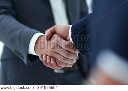 Handshake business concept in office