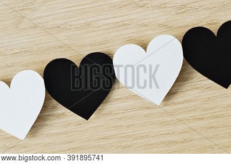 Black And White Hearts Linked Together In A Chain - Anti-racism Concept