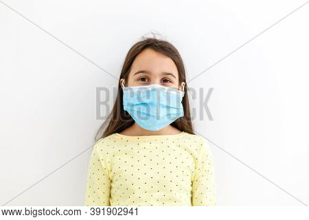 Masked Child Protection Against Influenza Virus. Little Caucasian Girl Wearing Mask For Protect Pm2.