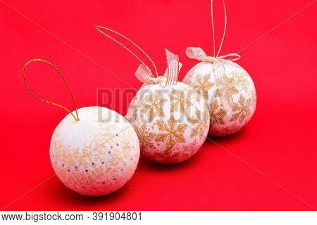 Christmas Toys, White Balls, Three Pieces, Air Lungs, In A Row, On A Red Background