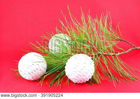 Christmas Decorations, Composition, White Balls, Green Branch, Pine, On A Red Background Design