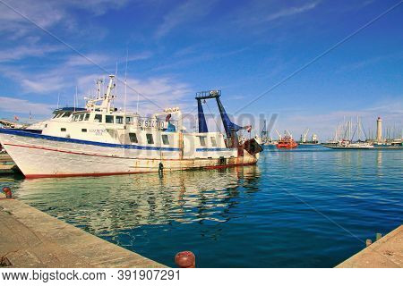 Sete, France - September, 21, 2014: Tuna Boats And  Lighthouse Of The Saint-louis Mole In Sete - Fas