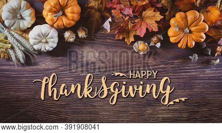 Thanksgiving Background Decoration From Dry Leaves And Pumpkin On  Wooden Background. Flat Lay, Top