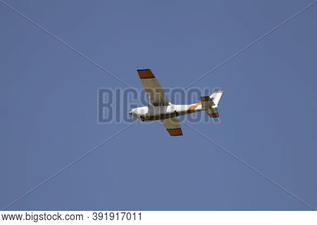 Small Hite Plane Flies In The Sky. Takeoff And Landing. Arrival And Departure. Place For Your Text.