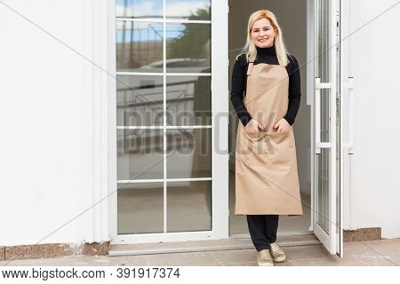 Portrait Of Beautiful Caucasian Girl Self-employed In Flower Shop, Smiling And Looking At Camera. Ho
