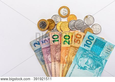Money From Brazil On A White Background, One Hundred, Fifty, Twenty, Ten, Five And Two Reais, With C