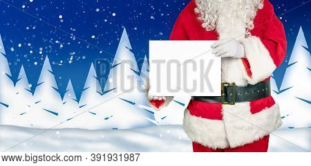 Santa Holds An Empty White Sign For Advertising In The Camera Wintery Background With Snowflakes