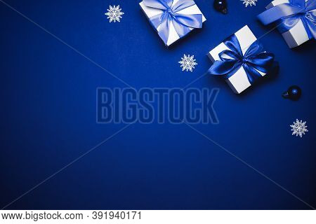 Winter Background Blue. White Gift With Cyan Bow, Blue Balls And Winter Tree In Xmas Decoration On A