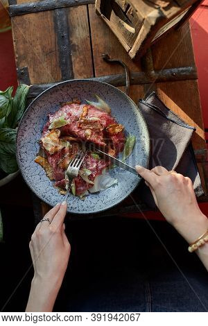 A Female Hand Is Preparing A Vegetable Salad With Beef Roast Beef. A Plate Of Salad With Beef Roast