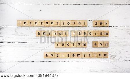 International Day Against Fascism, Racism And Antisemitism. Words From Wooden Cubes With Letters. Ph