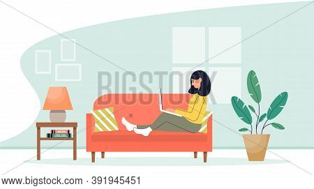Girl With Laptop Sitting On The Sofa. Home Office. Work At Home Or Freelance. Homeschooling. Online