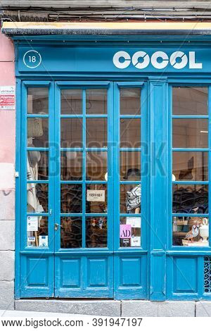 Madrid, Spain - 4th October, 2020: Blue Painted Store Window Of A Fashion Accessories Store In Latin