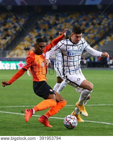 Kyiv, Ukraine - October 27, 2020: Tete Of Shakhtar Donetsk (l) Fights For A Ball With Alessandro Bas