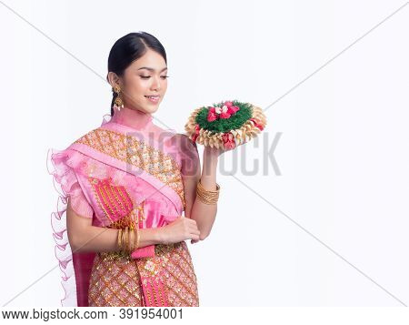 Attractive Thai Woman Dressed In Traditional Thai Clothes Holds A Flower Basket