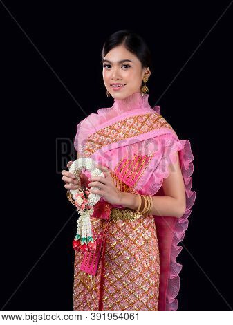 Attractive Thai Woman Dressed In Traditional Thai Clothes Holds A Flower Garland Made From Natural M