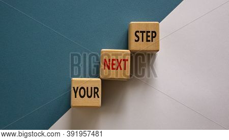 Conceptual Image Of Motivation. Wooden Cubes With Words 'your Next Step'. Beautiful White And Blue B