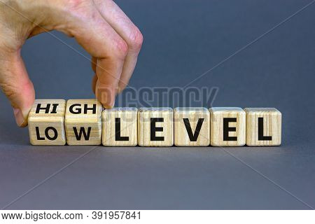 Hand Turns A Cubes And Changes The Expression 'low Level' To 'high Level' Or Vice Versa. Beautiful G