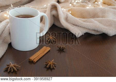 Living Room Details In Winter. Close-up Of A White Cup With An Infusion On A Wooden Table With Anise