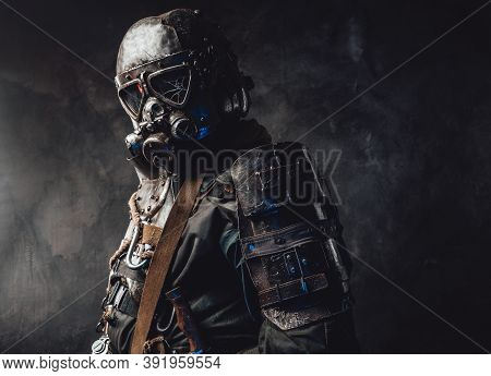 Epidemic And Apocalyptic Survivor Dressed In His Custom Dark Armour And Gas Mask With Broken Glass I