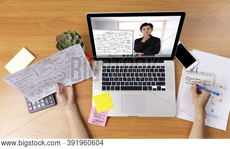 High Angle View Of Video Conference With Teacher On Laptop At Home. Top View Businesswomen Using Lap